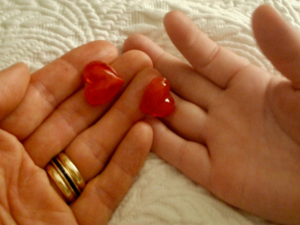teddy and mom, heart in hands